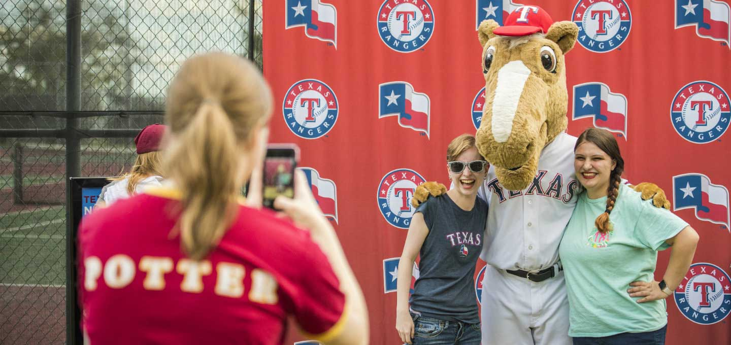 TWU students pose with the Texas Rangers Mascot.