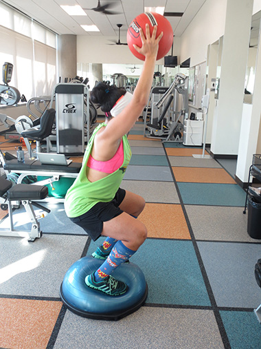 Woman working out at TWU Houston Fitness Center