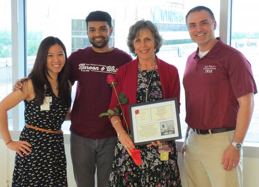 From left to right: Katiana Oro, Jogesh Kamta, Suzanne Scheller, Redbud Award Recipient for Heart of Service and Compassion, Will Khalil