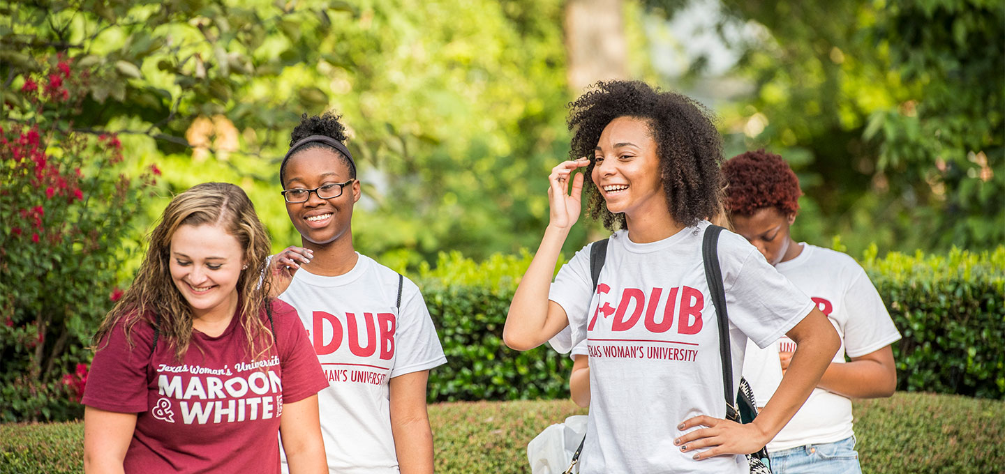 Smiling students in their shirts that say T-DUB.