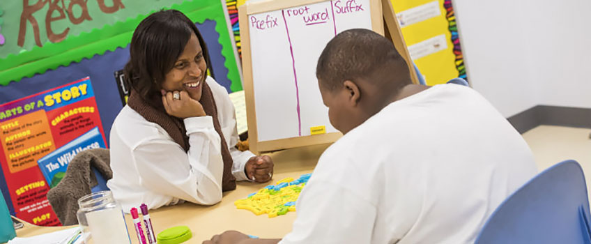 African-American teacher working one-on-one with African-American student