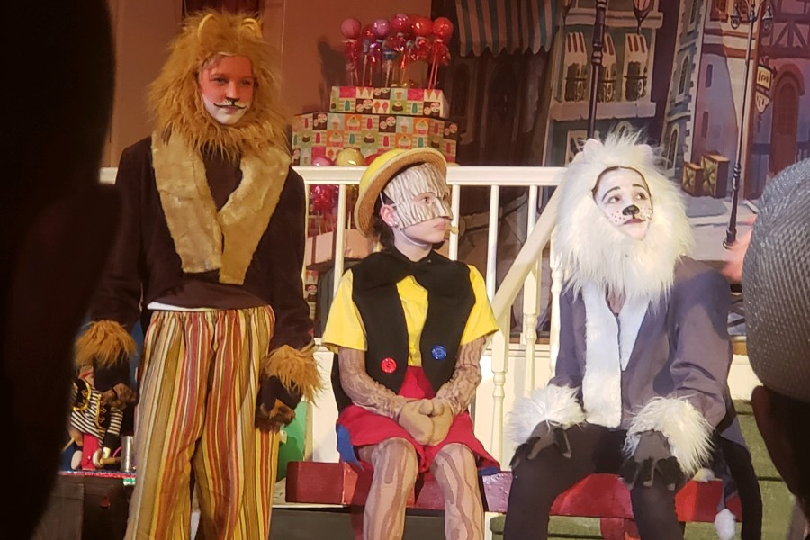 Three children dressed up as Wizard of Oz characters