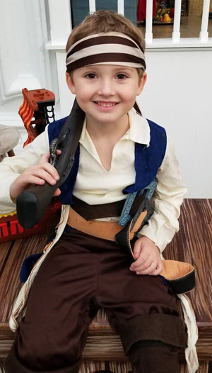 A young boy dressed up as a pirate for a musical