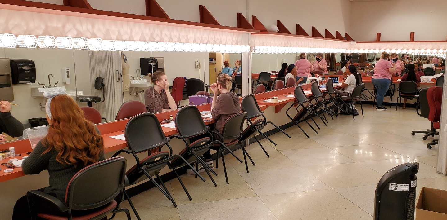 Student actors getting ready in the TWU Redbud Makeup room
