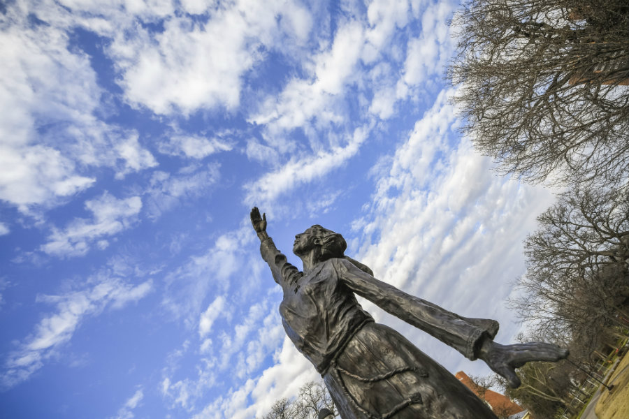 Statue of a girl reaching to the sky on TWU's Denton campus.