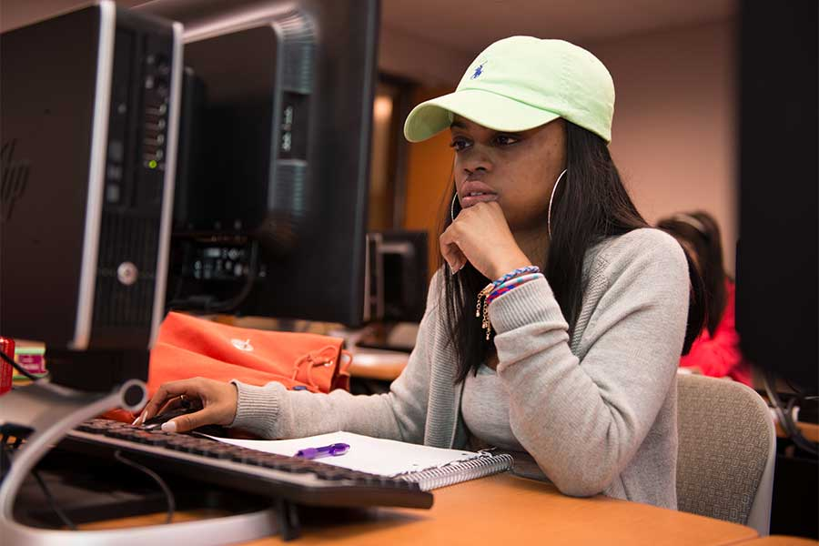 A TWU student works at a computer in a lab on the Denton campus.