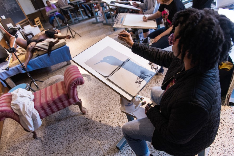 TWU students drawing from a live model