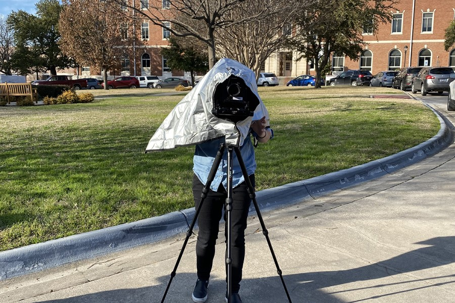 Student with a camera on a tripod