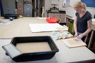 A TWU student working on a papermaking project in our studio.