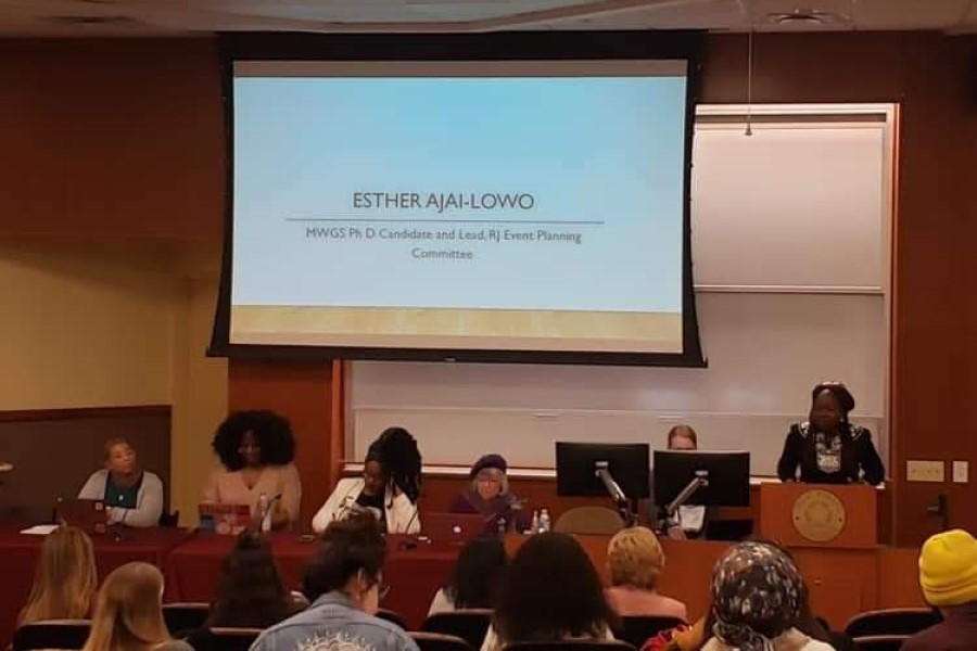 Esther Ajayi-Lowo, MWGS doctoral candidate and planning committee chair, introduces the panel and defines reproductive justice.