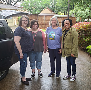 From left to right: Shelia Bickle, Bickle's daughter, Marcia Niemann, and Danielle Philllips-Cunningham.