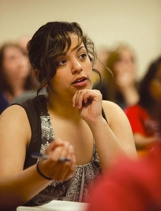 A student asking a question during a lecture.