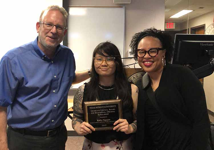Kathy Nguyen pictured between MWGS' Interim Chair Dr. Mark Kessler and Associate Professor Dr. Danielle Phillips-Cunningham.